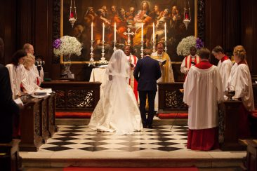 Bride and groom at altar in a church